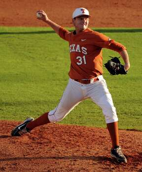 Texas' Chad Hollingsworth delivers a pitch during the fifth inning of an NCAA baseball regional game against Texas A&M, Monday, June 2, 2014, at Reckling Park in Houston. Photo: Eric Christian Smith, For The Chronicle