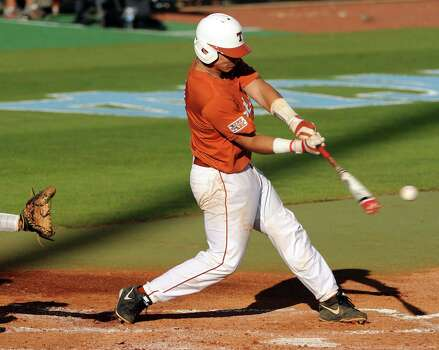 Texas' Tres Barrera connects for an RBI single for the Longhorns' first run of the game during the first inning of an NCAA baseball regional game against Texas A&M, Monday, June 2, 2014, at Reckling Park in Houston. Photo: Eric Christian Smith, For The Chronicle
