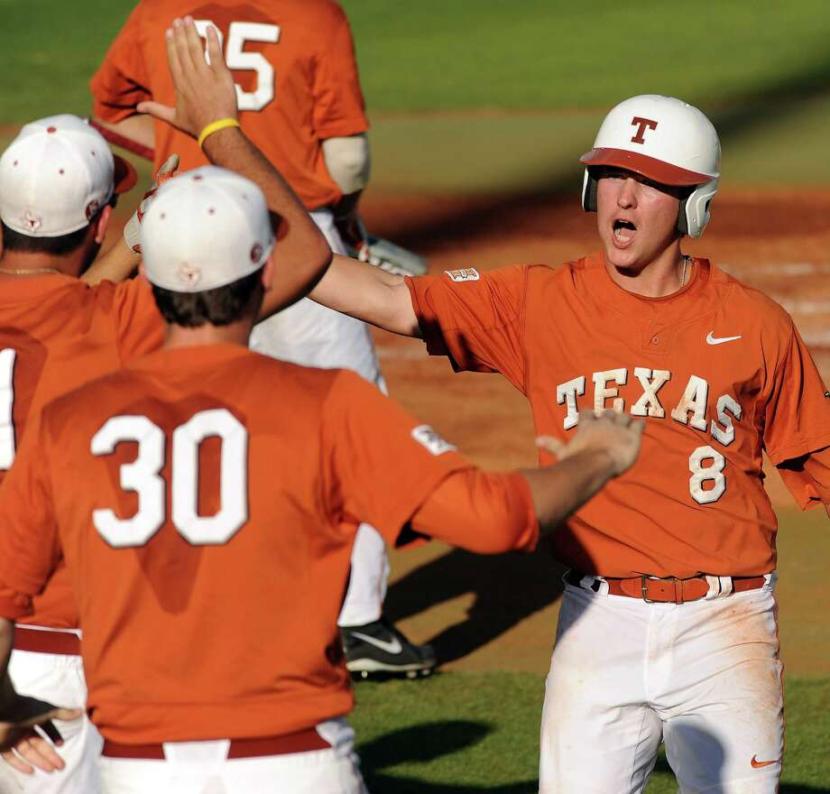 Texas' Brooks Marlow (8) celebrates scoring the Longhorns' first run of the game during the first inning of an NCAA baseball regional game against Texas A&M, Monday, June 2, 2014, at Reckling Park in Houston. Photo: Eric Christian Smith, For The Chronicle