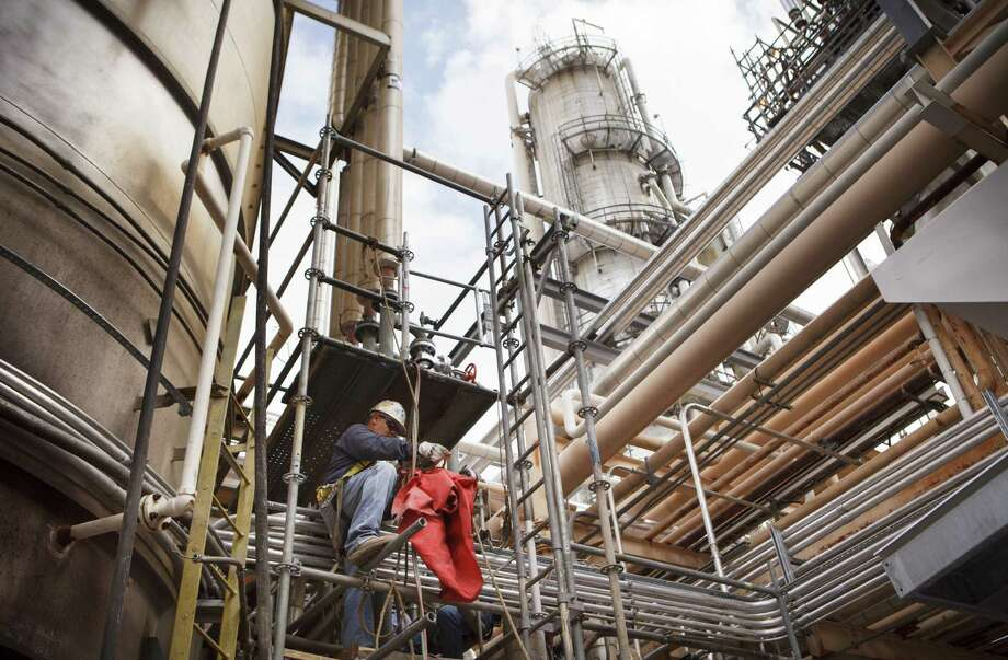 """A worker navigates a structure at Valero Energy's refinery in Three Rivers. Valero slipped slightly but managed to place in Fortune 500's top 10. Fortune said of Valero: It has """"benefited from increased oil and gas production in North America."""" Photo: New York Times File Photo / NYTNS"""