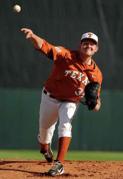Texas' Chad Hollingsworth delivers a pitch during the first inning of an NCAA baseball regional game against Texas A&M, Monday, June 2, 2014, at Reckling Park in Houston. Photo: Eric Christian Smith, For The Chronicle