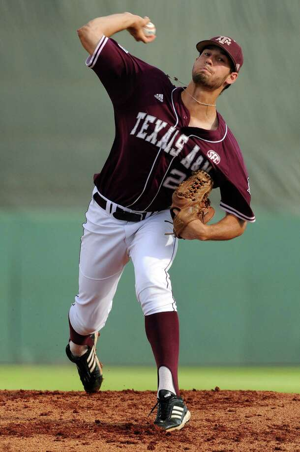 Texas A&M's Corey Ray delivers a pitch during the first inning of an NCAA baseball regional game against Texas, Monday, June 2, 2014, at Reckling Park in Houston. Photo: Eric Christian Smith, For The Chronicle