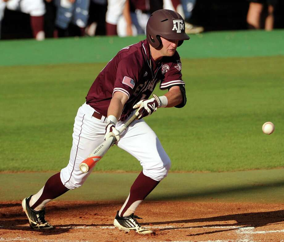 Texas A&M's Krey Bratsen lays down a sacrifice bunt during the second inning of an NCAA baseball regional game against Texas, Monday, June 2, 2014, at Reckling Park in Houston. Photo: Eric Christian Smith, For The Chronicle