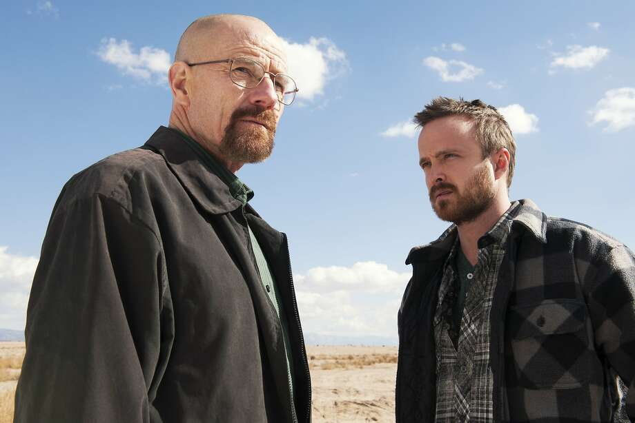 "This image released by AMC shows Bryan Cranston as Walter White, left, and Aaron Paul as Jesse Pinkman in a scene from ""Breaking Bad."" The Nielsen company, for the first time this season, is measuring how many people are reading Twitter messages about particular TV programs the night they are on the air. Nielsen said Monday, June 2, 2014, that the drug-dealing drama starring Bryan Cranston had an average of 6 million people seeing tweets for each episode. The show was boosted by its finale last September, where the number shot up to 9.1 million. (AP Photo/AMC, Frank Ockenfels ) Photo: Frank Ockenfels, Associated Press"
