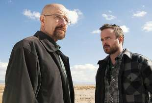 "This image released by AMC shows Bryan Cranston as Walter White, left, and Aaron Paul as Jesse Pinkman in a scene from ""Breaking Bad."" The Nielsen company, for the first time this season, is measuring how many people are reading Twitter messages about particular TV programs the night they are on the air. Nielsen said Monday, June 2, 2014, that the drug-dealing drama starring Bryan Cranston had an average of 6 million people seeing tweets for each episode. The show was boosted by its finale last September, where the number shot up to 9.1 million. (AP Photo/AMC, Frank Ockenfels )"