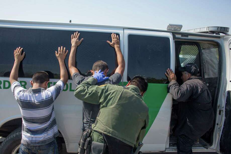 Two unaccompanied 17-year-old Honduran boys are taken into custody by U.S. Border Patrol minutes after being smuggled on a raft Saturday. Photo: Johnny Hanson / © 2014  Houston Chronicle