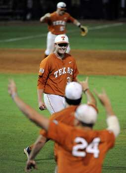 Texas pitcher Chad Hollingsworth, center, smiles after  the Longhorns' 4-1 victory over Texas A&M, in an NCAA baseball regional game, Monday, June 2, 2014, at Reckling Park in Houston. Photo: Eric Christian Smith, For The Chronicle
