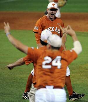Texas pitcher Chad Hollingsworth, top,  celebrates the Longhorns' 4-1 victory over Texas A&M, in an NCAA baseball regional game, Monday, June 2, 2014, at Reckling Park in Houston. Photo: Eric Christian Smith, For The Chronicle