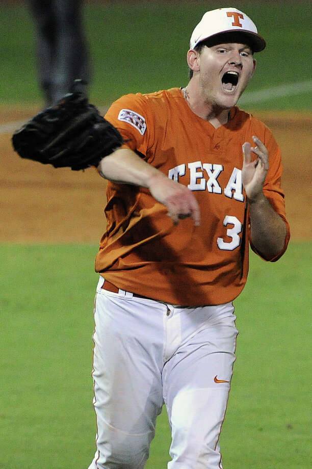 Texas pitcher Chad Hollingsworth celebrates the Longhorns' 4-1 victory over Texas A&M, in an NCAA baseball regional game, Monday, June 2, 2014, at Reckling Park in Houston. Photo: Eric Christian Smith, For The Chronicle