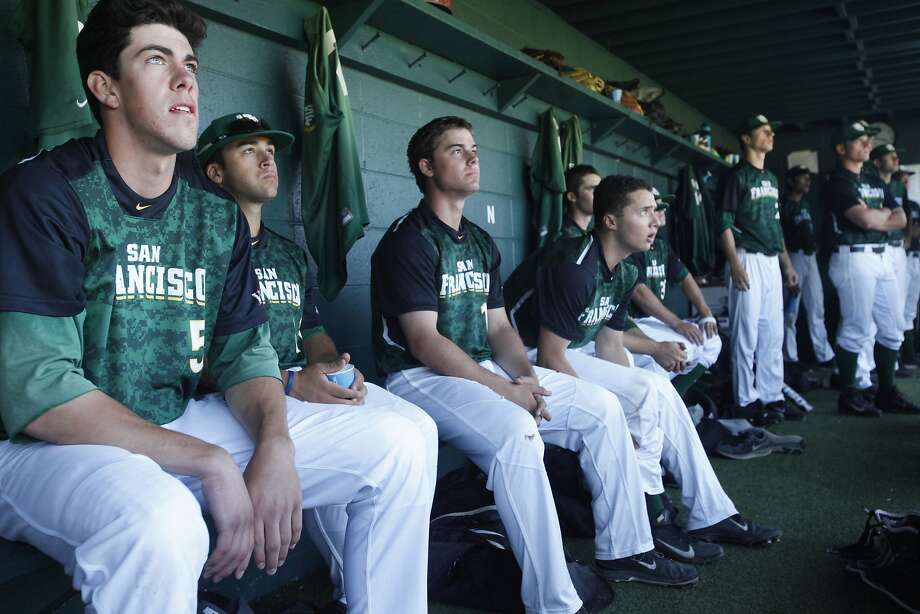 Bradley Zimmer (left) watches from the USF dugout as the Dons bat. He hit .368 with seven home runs this season. Photo: Leah Millis, The Chronicle