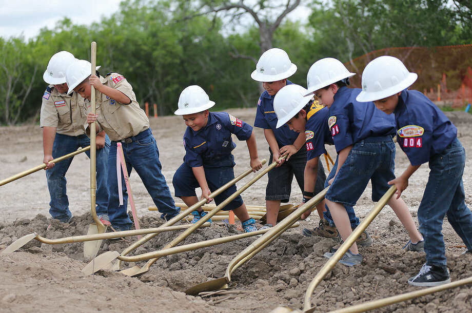 Cub Scouts in hardhats from Collier and Columbia Heights elementary schools perform the honors during groundbreaking for the Mays Family Scout Ranch. Photo: Jerry Lara / San Antonio Express-News / © 2014 San Antonio Express-News