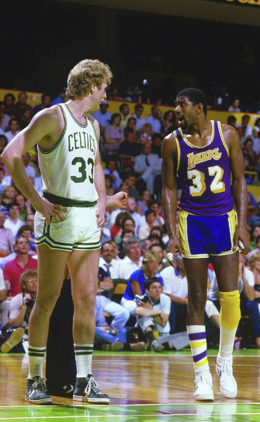 Magic Johnson. In this file photo of the 1984 NBA Finals, famed Celtic Larry Bird, and Laker Magic Johnson face off at The Boston Garden. The Celtics would win the series 4 games to 3.