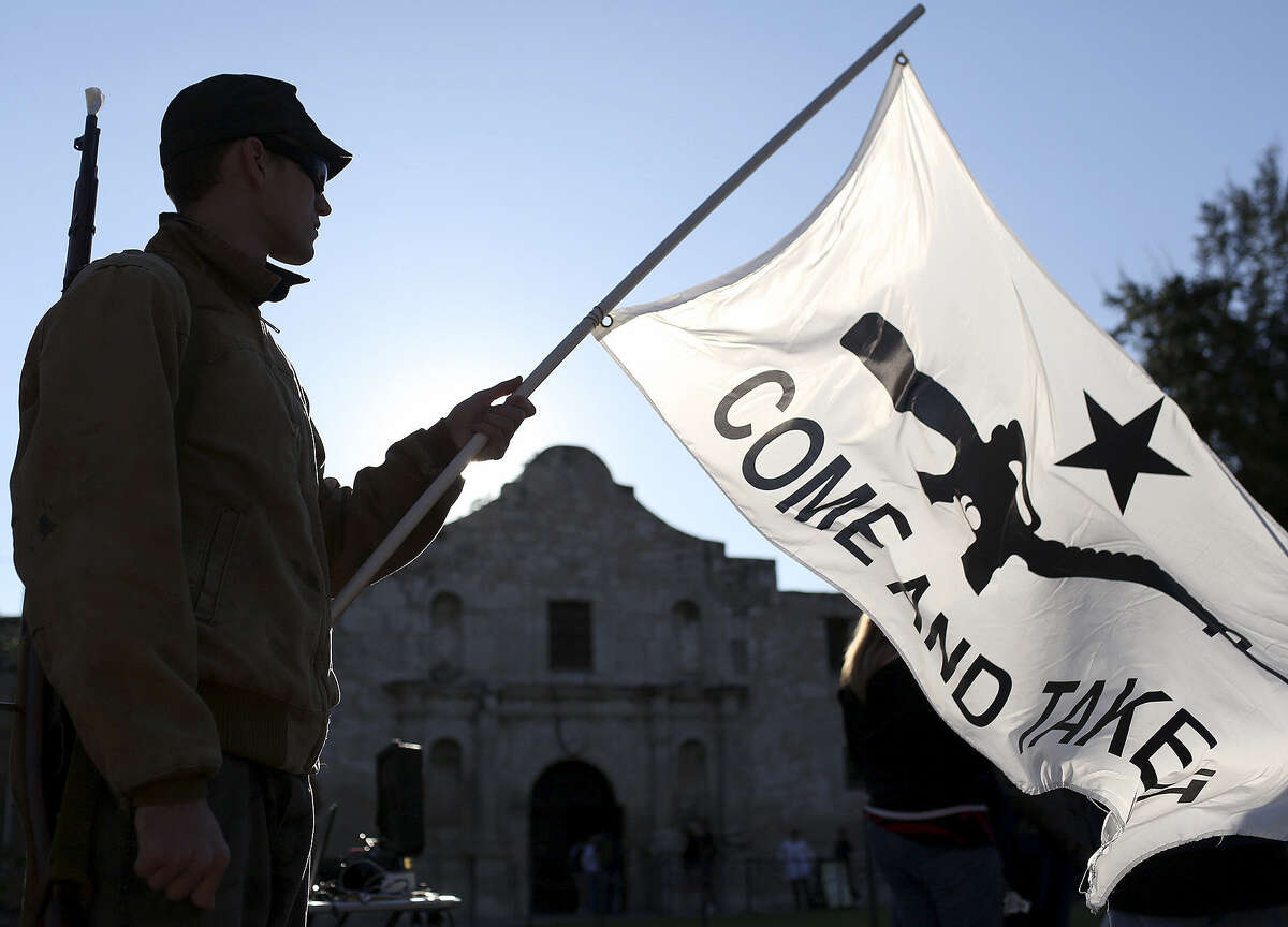 Michael Devine of Temple, a member of the Texas State Militia, waits for a gun-rights rally to begin at the Alamo in October.