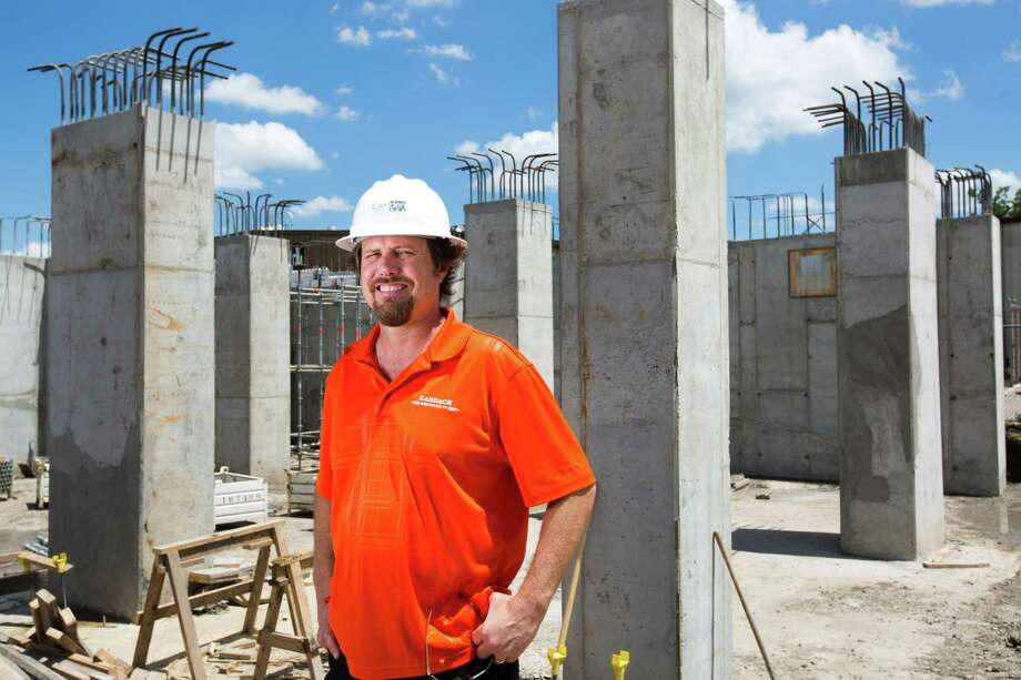 Eric Warner Karbach Brewing brewmaster stands by the construction site where the new brewing tanks will  be placed. The project, which will also include a restaurant, will give Karbach immediate capacity to produce 60,000 barrels annually. Monday, June 2, 2014, in Houston. ( Marie D. De Jesus / Houston Chronicle ) Photo: Marie D. De Jesus, Staff / © 2014 Houston Chronicle