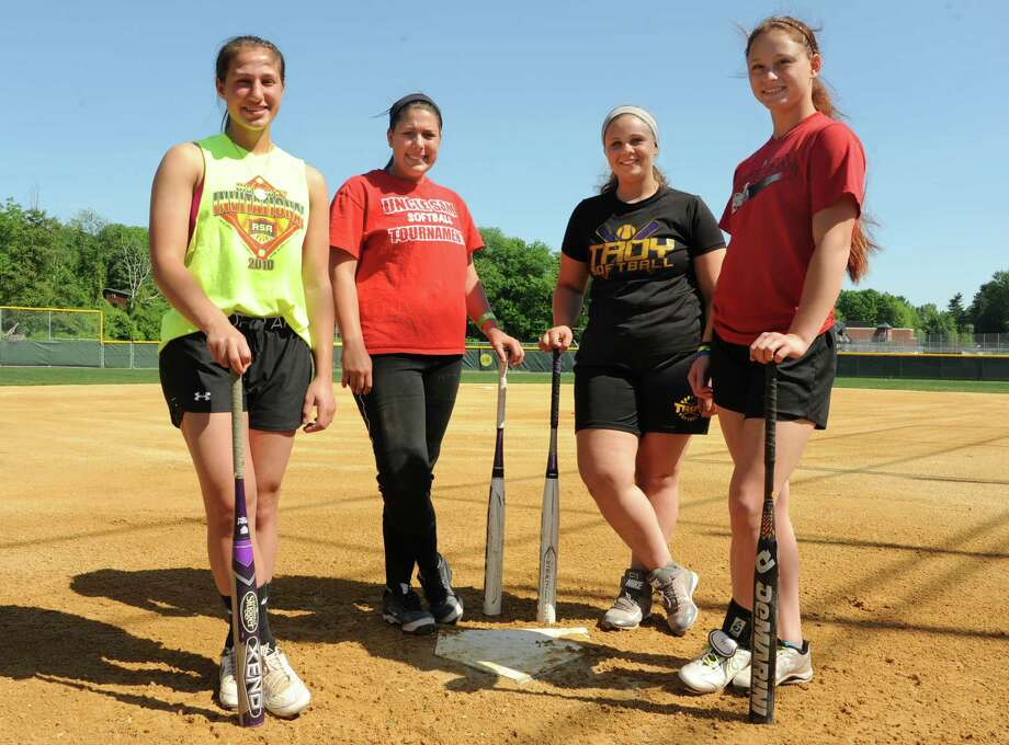 Troy junior softball players, from left: Alina Germinerio, Victoria Hallett, Jessica Marsh and Brianna Bowen are pictured during at team practice Monday, June 2, 2014 in Troy, N.Y. (Lori Van Buren / Times Union) Photo: Lori Van Buren / 00027138A