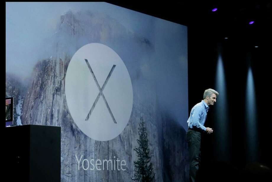 Apple senior vice president of Software Engineering Craig Federighi introduces the Yosemite operating system during the Apple Worldwide Developers Conference in San Francisco, Monday, June 2, 2014. Photo: Jeff Chiu, STF / AP