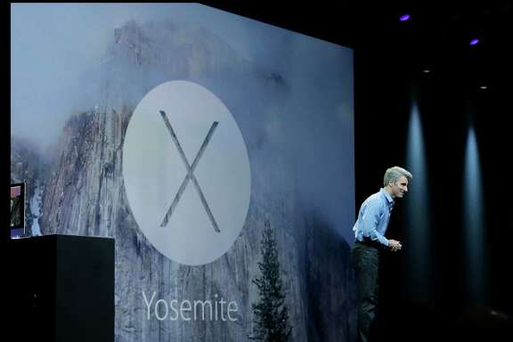 Apple senior vice president of Software Engineering Craig Federighi introduces the Yosemite operating system during the Apple Worldwide Developers Conference in San Francisco, Monday, June 2, 2014. (AP Photo/Jeff Chiu)