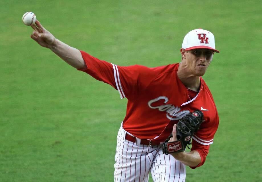 Houston pitcher Andrew Lantrip (13) pitches in the first inning of an NCAA college baseball regional tournament game against LSU in Baton Rouge, La., Monday, June 2, 2014. (AP Photo/Gerald Herbert) Photo: Gerald Herbert, Associated Press / AP
