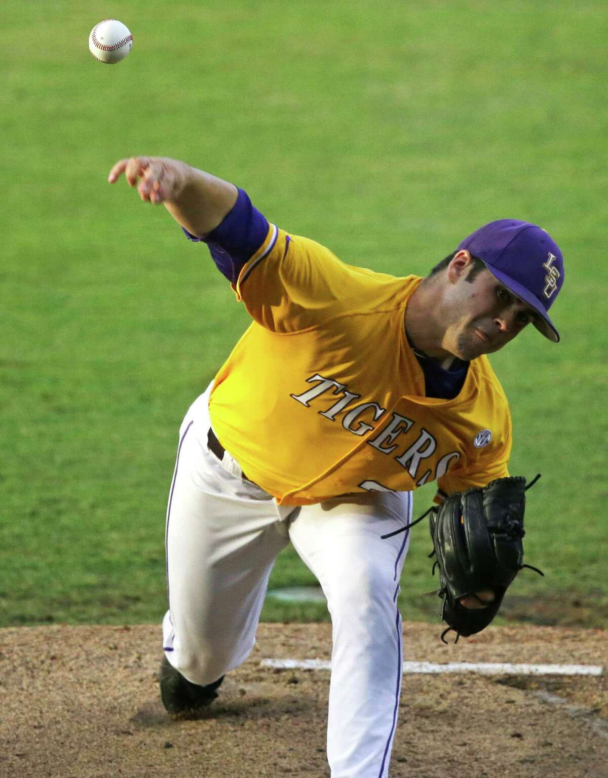 LSU pitcher Alden Cartwright works in the first inning of an NCAA college baseball regional tournament game against Houston in Baton Rouge, La., Monday, June 2, 2014. (AP Photo/Gerald Herbert)