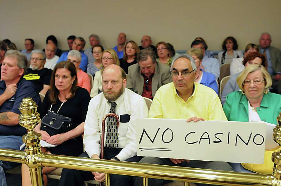 Supporters and non-supporters of casinos listen as Schenectady County lawmakers host a public hearing on plans to build a casino on Erie Boulevard Monday, June 2, 2014 in Schenectady, N.Y. The casino is part of a project to redevelop a stretch of Mohawk River-side that was once home to Alco, the locomotive manufacturer. (Lori Van Buren / Times Union) Photo: Lori Van Buren / 00027146A