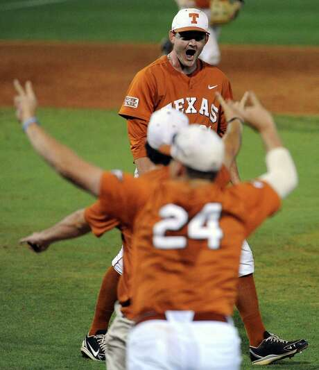 Texas pitcher Chad Hollingsworth, background, celebrates the Longhorns' 4-1 victory over Texas A&M in the Houston Regional at Reckling Park on Monday night. Hollingsworth, making his first start this season, threw a two-hitter and struck out three to improve to 3-0. Photo: Eric Christian Smith, Freelance