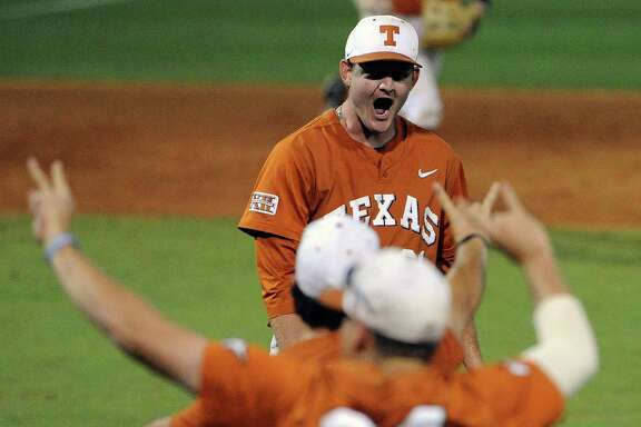 Texas pitcher Chad Hollingsworth, background, celebrates the Longhorns' 4-1 victory over Texas A&M in the Houston Regional at Reckling Park on Monday night. Hollingsworth, making his first start this season, threw a two-hitter and struck out three to improve to 3-0.