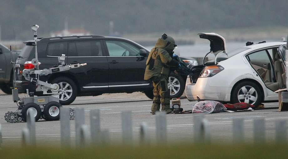 A bomb squad member with the help of a robot investigates the automobile that  Ryan Chamberlain was arrested in at Crissy Field in San Francisco on Monday, June 2, 2014. Photo: Mathew Sumner, Special To The Chronicle