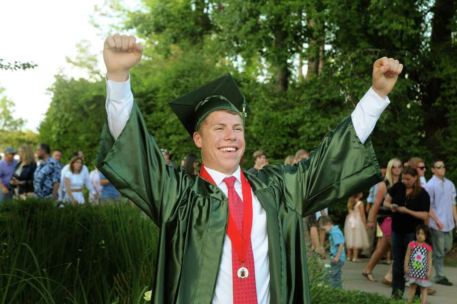Graduate Brad Bentley celebrates during The Woodlands High School graduation ceremony at the Cynthia Mitchell Pavilion. Almost 1,000 graduates crossed the stage to receive their diploma.  Photo: David Hopper, For The Chronicle / freelance