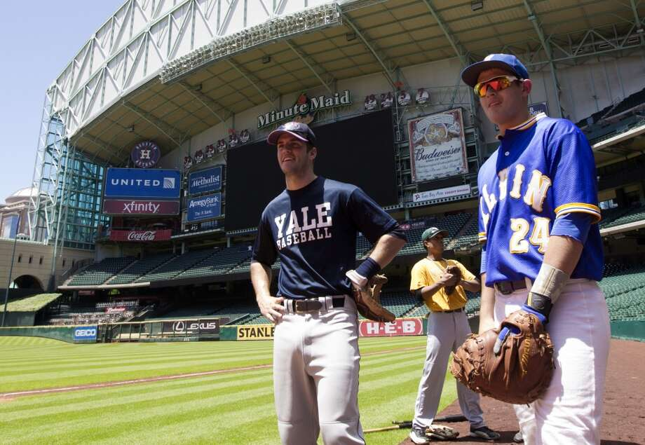 Yale's team captain Cale Hanson and Klein High School baseball player Nick Slaughter participate in the Houston Astros pre-draft workout at Minute Maid Park on Monday, June 2, 2014, in Houston. ( J. Patric Schneider / For the Chronicle ) Photo: For The Chronicle