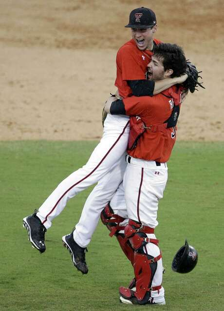 Texas Tech pitcher Cameron Smith (left) jumps into the arms of Hunter Redman after throwing a shutout at Miami. Photo: Lynne Sladky / Associated Press / AP