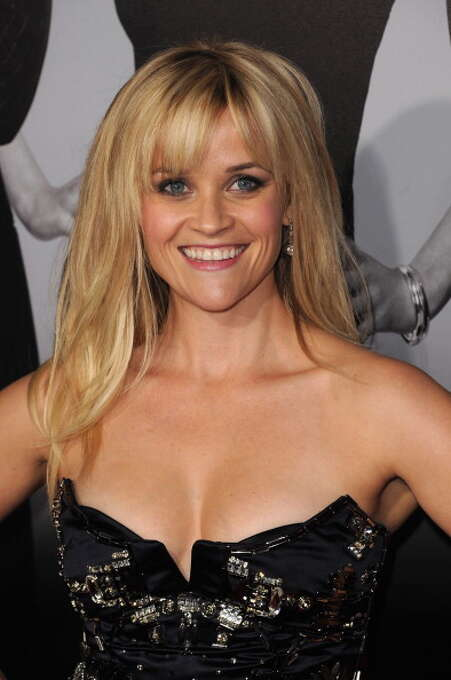 """Reese Witherspoon attends the premiere of Twentieth Century Fox's """"This Means War"""" (2012), a horrible romantic comedy that she could not fight her way out of. Photo: Jason Merritt, Getty Images / 2012 Getty Images"""
