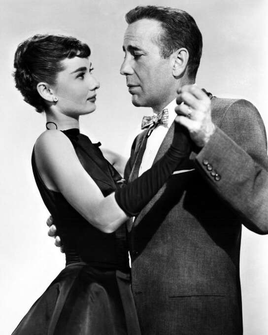 """Everything wrong with Humphrey Bogart in """"Sabrina"""" (1954) is obvious from the production still.  Would you want that guy kissing you?  So imagine how Audrey Hepburn must have felt about it? Photo: Silver Screen Collection, Getty Images / 2013 Getty Images"""