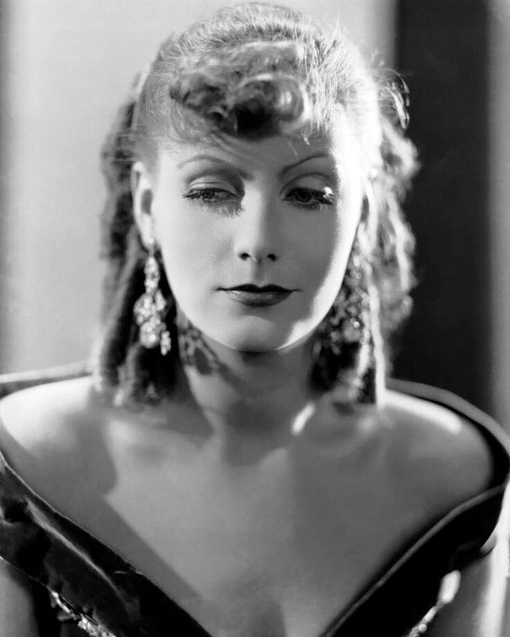 Swedish actress Greta Garbo (1905 - 1990) in a promotional portrait for 'Romance', directed by Clarence Brown, 1930. It's about the only time Garbo seems odd on screen.  She plays an Italian opera singer and does an Italian accent on top of her own Swedish accent.  The effect is bizarre. Photo: Silver Screen Collection, Getty Images / 2013 Getty Images