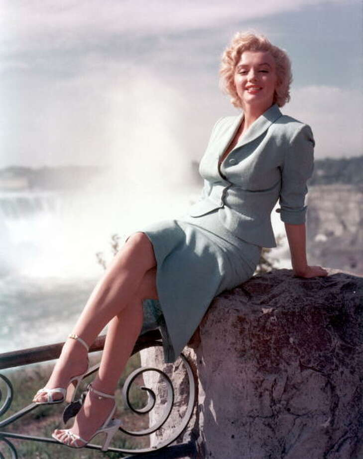 "Marilyn Monroe poses for a portrait in front of Niagara Falls dressed as Rose Loomis from the film ""Niagara"" which was released on January 21, 1953 and filmed partially on location.  She looked great.  That was for sure.  But as Francois Truffaut pointed out in his review at the time, Marilyn was not at home playing evil roles. Photo: Michael Ochs Archives, Getty Images / Moviepix"