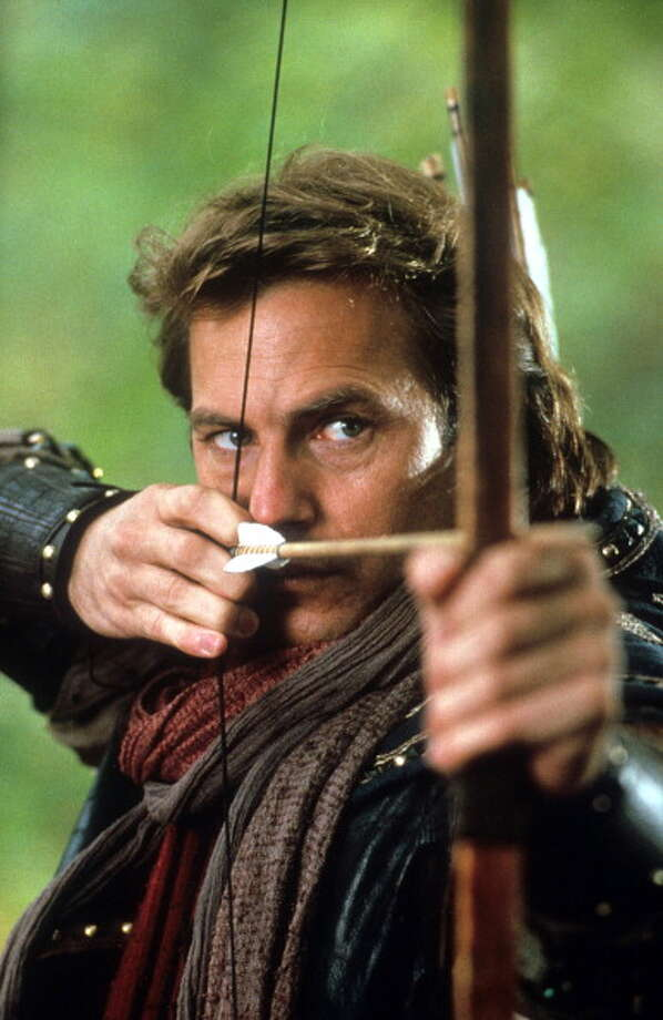Kevin Costner aiming bow and arrow in a scene from the film 'Robin Hood: Prince Of Thieves', 1991. He couldn't do an English accent but couldn't resist trying. Photo: Warner Bros., Getty Images / 2013 Getty Images