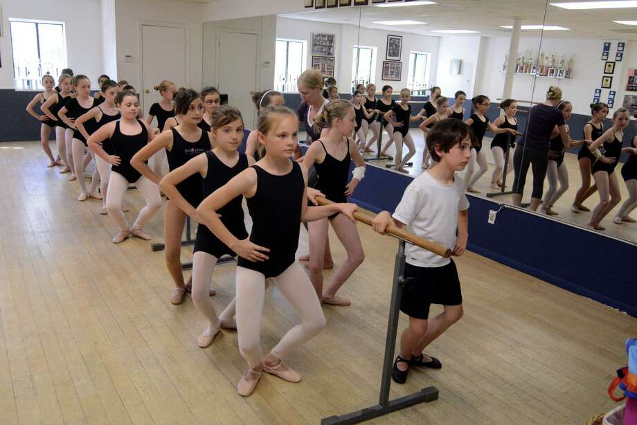 Jennifer Lancaster teaches her ballet students at Just Dance studio in Danbury on Monday June 2, 2014. The studiois celebrating their 10th Anniversary this year. Photo: Lisa Weir / The News-Times Freelance