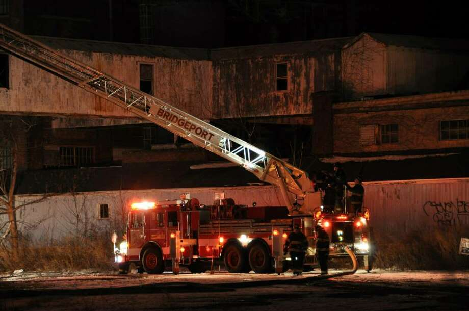 "A stubborn blaze heavily damaged a vacant factory Sunday night that fire officials say is the site of many previous fires. The fire at the corner of Seaview Avenue and Grant Street broke out about 5:45 p.m. and at one point was ""fully involved,"" according to fire officials. Photo: Kevin M Doyle, Contributed Photo / CT Post"