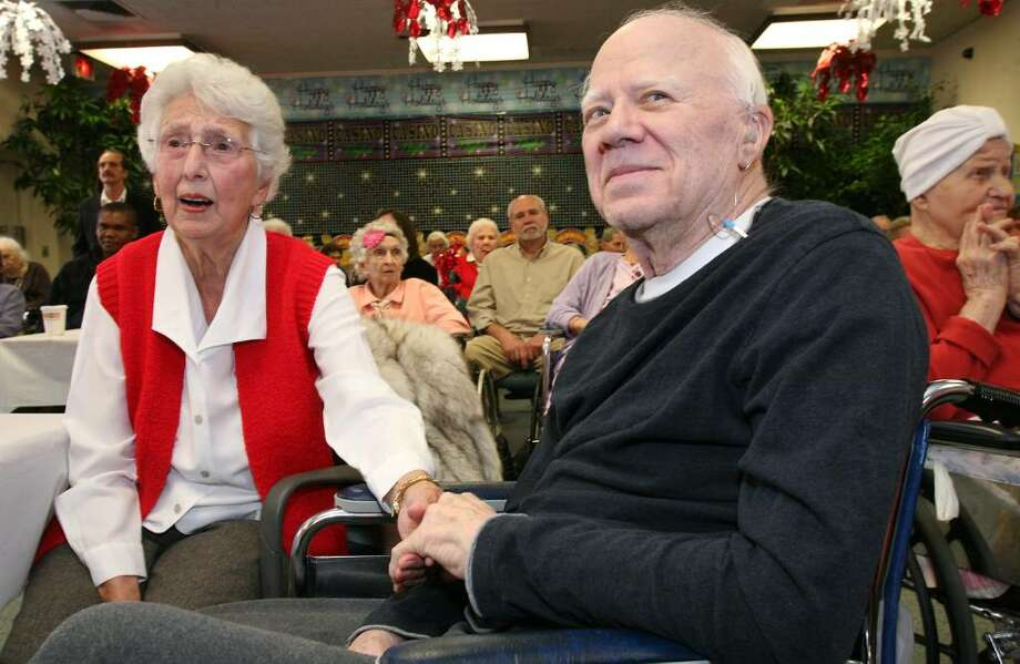 Nathaniel Witherell resident Bob Harriau and his valentine sweetheart Geraldine Christophersen spent the afternoon listening to the romantic tunes of the Bill Harris Quartet that played at the center Sunday. Photo: David Ames, David Ames/For Greenwich Time / Greenwich Time