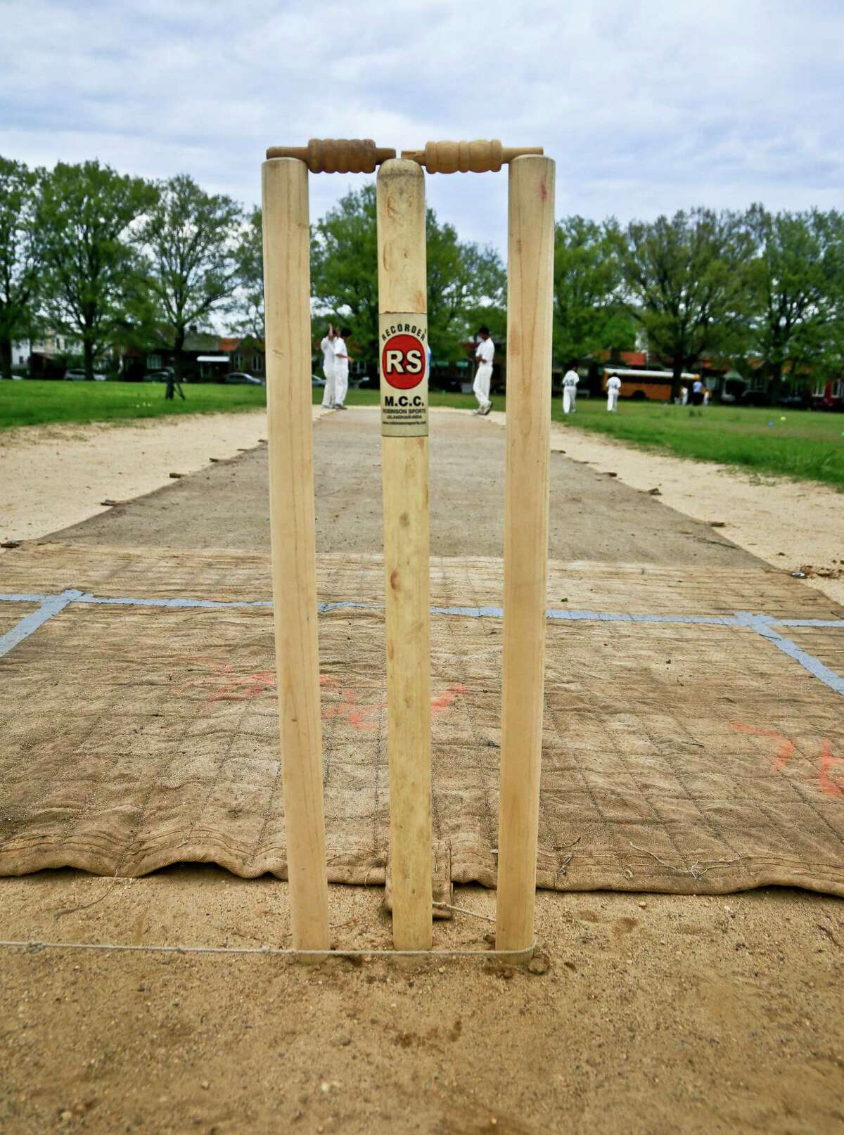 In this May 12, 2014 photo, a wicket - three wooden stump poles topped with two wooden crosspieces called bails - is set up for a Public School Athletic League (PSAL) cricket match between John Adams and Midwood high schools, at Marine Park in the Brooklyn borough of New York. The wicket, at the heart of a cricket match, is defended by a batsman who attempts to prevent a bowler's ball from hitting the wicket by first striking the ball to score