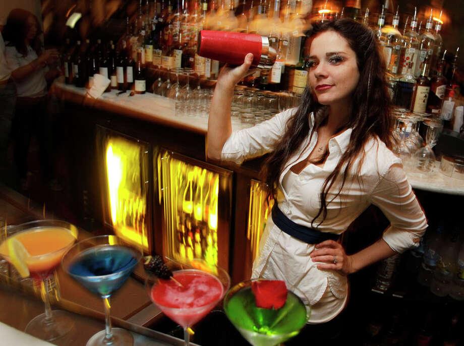 Bartender Destiny Ellis mixing drinks at Saint Genevieve. Photo: Melissa Phillip, Houston Chronicle / © 2011 Houston Chronicle