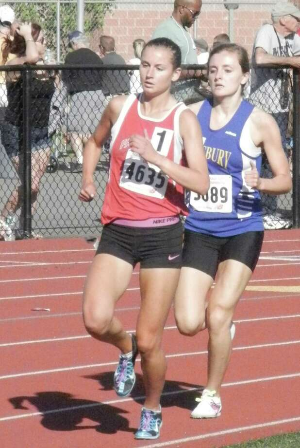 Fairfield Warde senior Cate Allen, left, leading Simsbury's Sarah Mattison in the 1,600-meter race on Monday, June 2 at the CIAC Class L boys and girls track championship meet at Middletown High School. Allen won the 1,600 and 800 meters but lost to Mattison at the wire in the 3,200. Warde finished third as a team. Photo: Reid L. Walmark / Fairfield Citizen