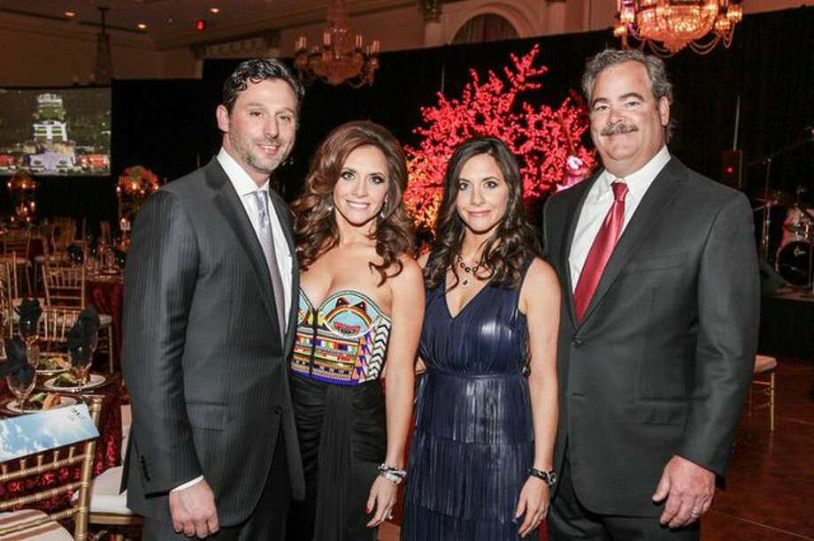 Brad and Joanna Marks, Hannah and Cal McNair at the Mission of Yahweh Mission Incredible Gala, A Heavenly Evening in Musical, Magical Vienna. May 2, 2014, Hilton Houston Post Oak. Photo: Kim Coffman