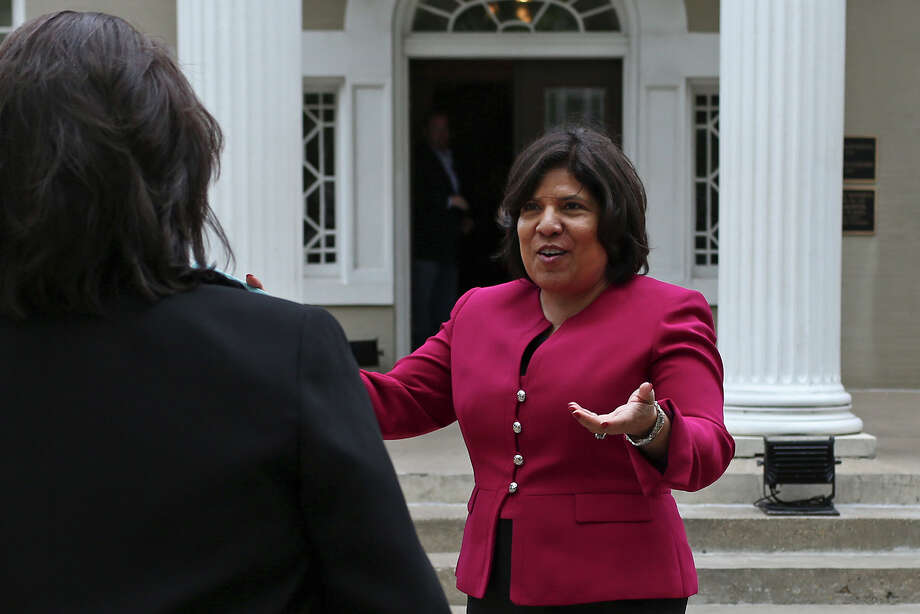 Grace Garcia, Executive Director of Annie's List, greets State Senator Leticia Van de Putte, left, as the Senator arrives at the Belo Mansion for an event as Van de Putte campaigns for Lt. Governor in Dallas on Thursday, April 3, 2014. Photo: Lisa Krantz, SAN ANTONIO EXPRESS-NEWS / SAN ANTONIO EXPRESS-NEWS