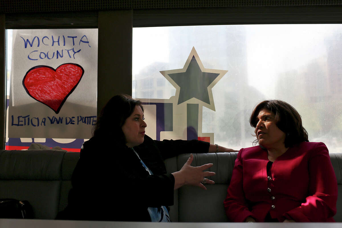 State Senator Leticia Van de Putte talks with Grace Garcia, right, Executive Director of Annie's List, as they ride to a campaign event as the Senator campaigns for Lt. Governor in Dallas on Thursday, April 3, 2014.