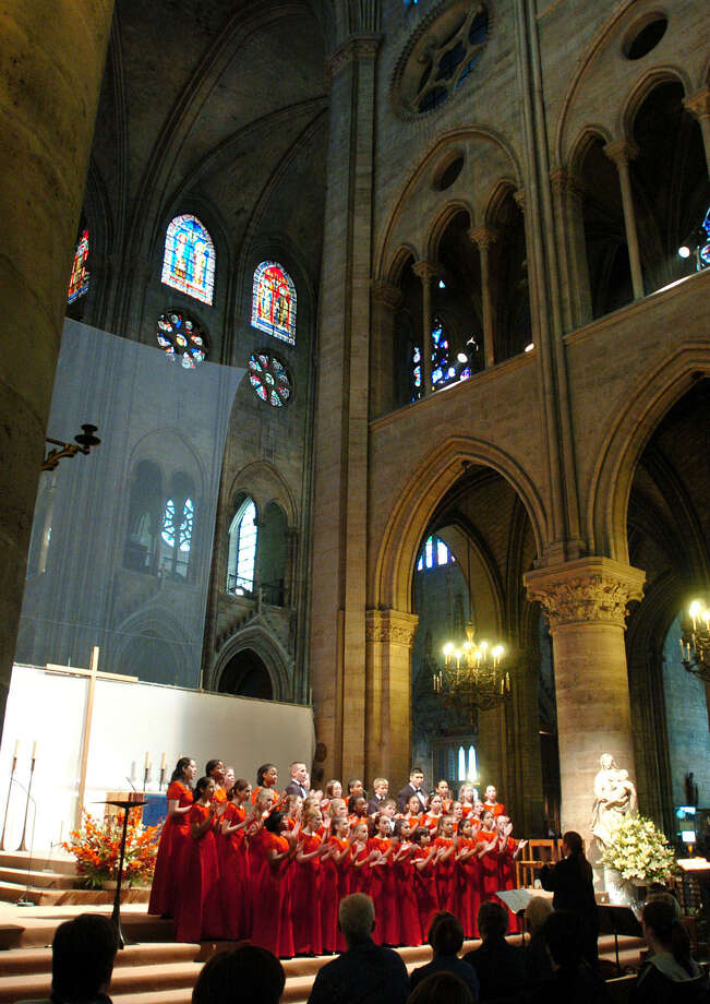 The Texas Children's Choir sings at the Notre Dame Cathedral in Paris in 2004. Another performance there Tuesday will mark the group's second trip to help commemorate the 1944 D-Day invasion of Europe. Photo: File Photo / San Antonio Express-News / SAN ANTONIO EXPRESS-NEWS