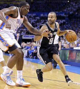 San Antonio Spurs' Tony Parker looks for room around Oklahoma City Thunder's Kendrick Perkins during first half action in Game 4 of the Western Conference Finals Tuesday May 27, 2014 at  Chesapeake Energy Arena in Oklahoma City, OK. Photo: Edward A. Ornelas, San Antonio Express-News