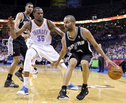 San Antonio Spurs' Tony Parker looks for room around Oklahoma City Thunder's Kevin Durant as San Antonio Spurs' Tim Duncan looks on during first half action in Game 4 of the Western Conference Finals Tuesday May 27, 2014 at Chesapeake Energy Arena in Oklahoma City, OK. Photo: Edward A. Ornelas, San Antonio Express-News