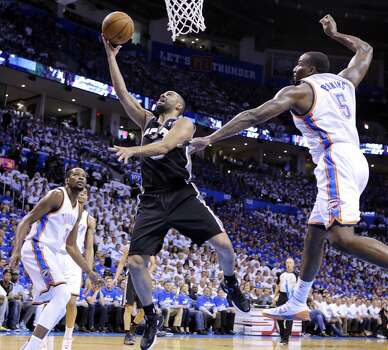 San Antonio Spurs' Tony Parker shoots around Oklahoma City Thunder's Kendrick Perkins during first half action in Game 4 of the Western Conference Finals Tuesday May 27, 2014 at Chesapeake Energy Arena in Oklahoma City, OK. Photo: Edward A. Ornelas, San Antonio Express-News