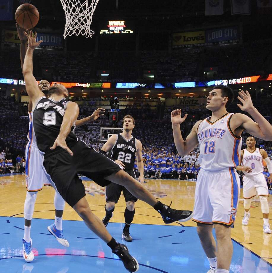 San Antonio Spurs' Tony Parker has his shot blocked by Oklahoma City Thunder's Kevin Durant as Steven Adams looks on during first half action in Game 4 of the Western Conference Finals Tuesday May 27, 2014 at Chesapeake Energy Arena in Oklahoma City, OK. Photo: Edward A. Ornelas, San Antonio Express-News