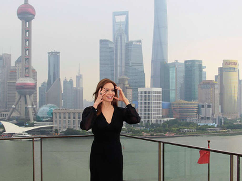 """Actress Angelina Jolie poses for a photo shoot at the Bund as she takes part on a promotion event for her movie """"Maleficent"""" in Shanghai, China Tuesday, June 3, 2014. Photo: AP / AP"""